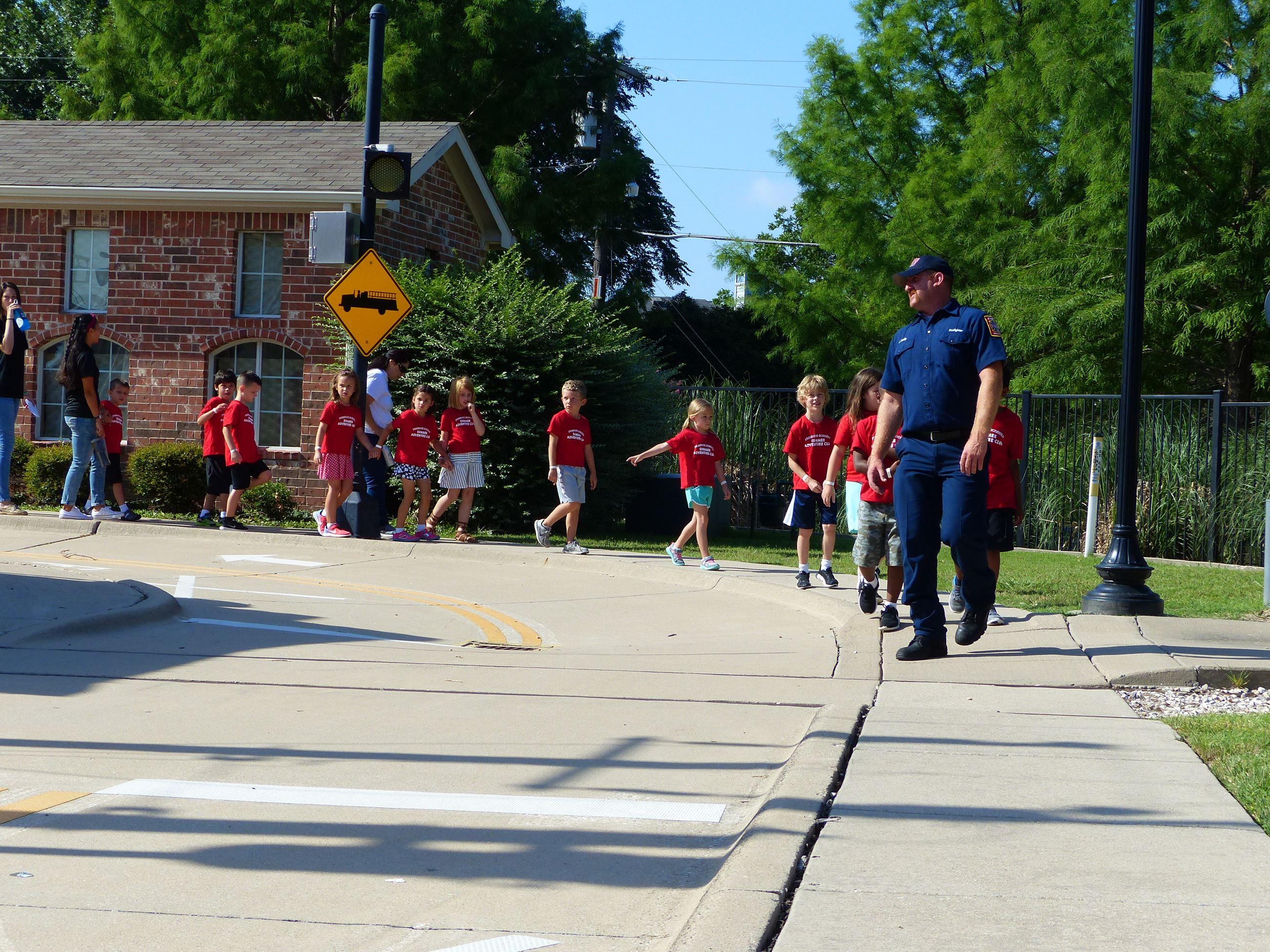 Group of young children walking around Safety Town village
